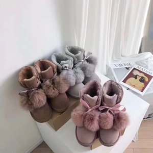 Wholesale Hot girl fox fur ball snow boots Classic fashion warm leather ladies snow boots