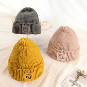 2018 Brand new baby children's hat autumn and winter boys and girls thick knitted sweater wool cap lovely design baby warm earmuffs