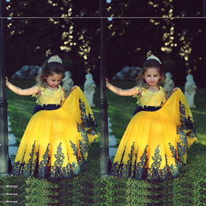 Wholesale 2019 Yellow Princess Flower Girls Dresses Sleeveless Lace Applique Bow Tulle Backless Jewel Wedding Children Communion Ball Gowns