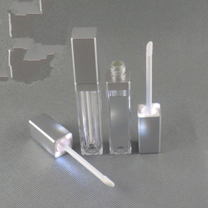 Wholesale 2019 LED light UP lip gloss container LED lip gloss bottle with mirror on one face black silver top