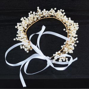 Bridal headwear, crown, hand-made pearl hair, bow tie, wedding dress and accessories.