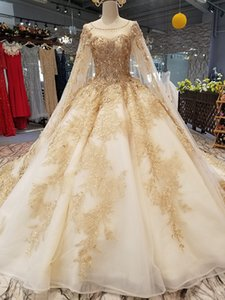 Wholesale 100% Real Photo Champagne Wedding Dresses Lace Appliques Tulle Beaded Crystal vestito da sposa Ball Gown Sheer Neck Long Sleeve Bridal Gowns
