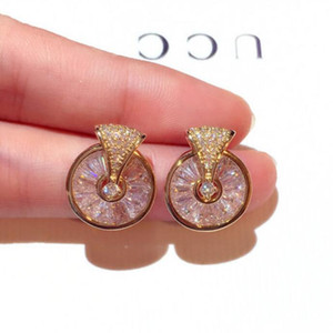 горячие туры оптовых-designer jewelry crystal stud earrings rotable circle round stud earrings for women hot fashion free of shipping