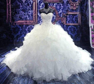 2019 Luxury Beaded Wedding Dresses Embroidery Puffy Organza Ruffles Ball Gown Bridal Gowns Sweetheart Corset Cathedral Princess Gown Cheap