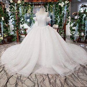 2019 Latest Bohemian Wedding Dresses Butterfly Sleeve Illusion O Neck Backless Lace Up Back Shining Crystal Sequins Appliques Bridal Gowns