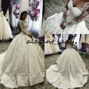 Wholesale crystal beaded corset princess wedding dress for sale - Group buy Luxury Sparkly Puffy Wedding Dresses Sheer O neck Long Sleeve Lace up Corset Back Beaded Crystal Arabic Princess Wedding Gown