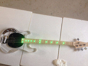 Wholesale Electric guitar green light acrylic quality bass providing personalized service