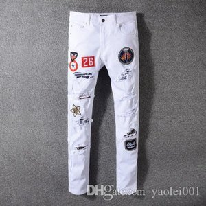 Wholesale High street mens fashion jeans trend hole white punk style badge decoration hole Slim feet trousers