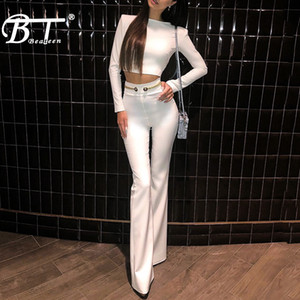Wholesale Beateen New Fashion Bandage Sets White Long Sleeve Crop Top Flare Leg Pant Suits With Gold Buttons Chains Belt Details