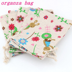 Wholesale 50pcs Cute bunny Pattern Linen Fabric Drawstring bags Candy Jewelry Gift Bag Cotton Linen Drawstring Bundle Bags x14cm