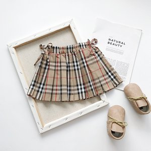Wholesale Retail kids luxury designer clothes girls bow plaid skirts Classic preppy princess dress pleated skirt Children boutique clothing off