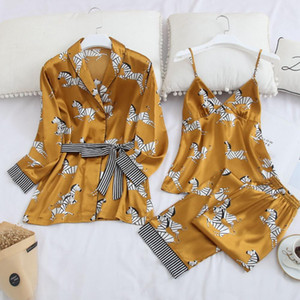 The new fall collection of women's pajamas, ice silk and chest cushion, is a hot three-piece cartoon print house