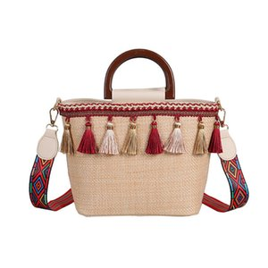 Wholesale New beach straw bag ethnic style ribbon tassel beach bag CK small red book stitching contrast color handbag tide