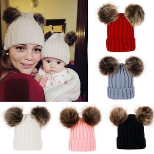 Wholesale baby army hat resale online - Cute Parent child Knit Hat Winter Warm Large Fur Pompon Hat Baby Mom Solid Pom Pom Beanie Ski Cap Head Warmer Knitted Caps LJJA2783