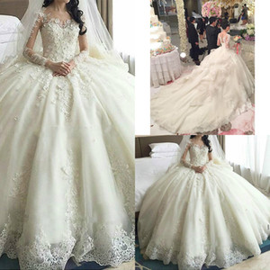 luxury ivory puffy ball gown lace wedding dresses with cathedral train organza beaded corset top Illusion long sleeve princess bridal gowns