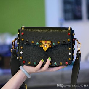 The new 2017 ms color rivet small bread worn across Europe and the United States the PU bag cover type woman messenger bag wide straps one s