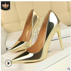 Wholesale European and American women style fashionable metal high heel shallow mouth pointy sexy nightclub show thin single shoes