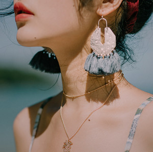 Wholesale Bohemian retro national style KC gold pendant ear decoration mysterious star moon pattern tassel earring first