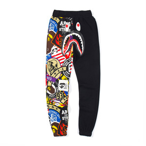Wholesale Tide Brand Lover Shark Head Print Graffiti Stitching Pants Trousers Men s Casual Personality Loose Long Pants Sizes M XL Free Shiping