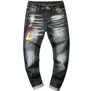 Wholesale Trend New Embroidery Yellow Butterfly Spray Paint Wave Point Slim Tight Straight Men s Jeans Hole Trousers