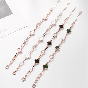Wholesale Hollow Four Clover Leaf Fashionable Designer Luxury Bracelet Bangles For Women Zircon Rhinestone Inlaid Black White Green and Pink