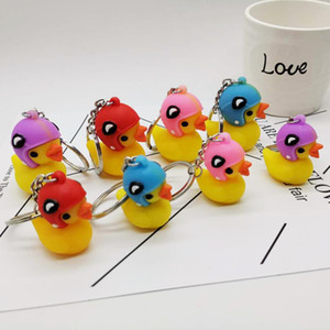 Wholesale Wearing a helmet small yellow duck keychain pendant D stereo PVC yellow duck Cute Key Chain bag hanging