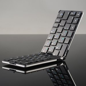 Wholesale Promotional metal folding wireless keyboard with remote controlled to take light and easy to carry for IOS Android Windows