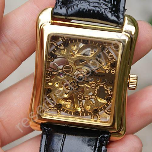 2018 Hombres de cuero negro Oro Esqueleto Mano Viento Reloj mecánico Unisex Vestido de mujer Relojes Ganador de la marca
