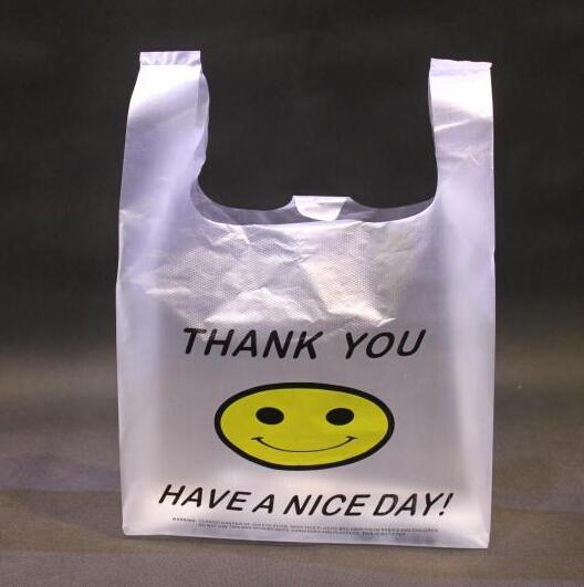 Wholesale- 100pcs 4 Size High Quality HDPE Supermarket Yellow Lovely Smile White Vest Plastic Carrier Shopping Hand Bag Packaging Bags Hot