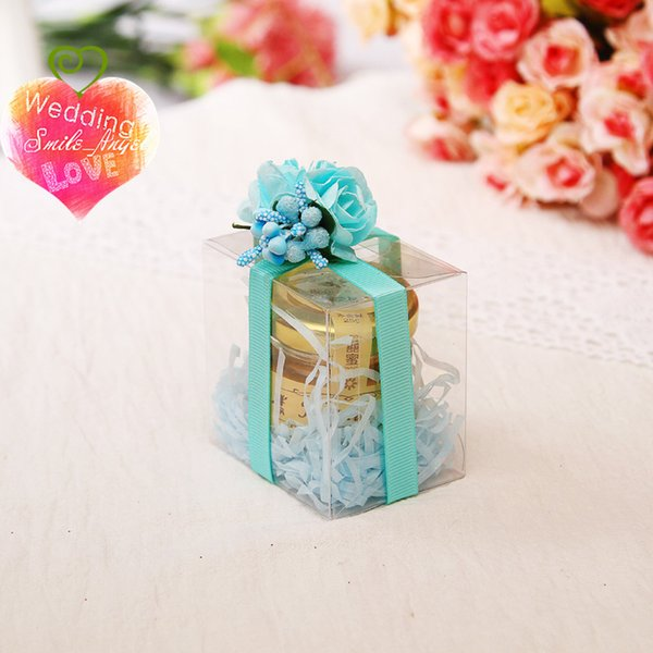 Nouvelles boîtes en PVC Transprent avec rubans et flores Faveurs de mariage spéciales Rouge bleu rose pour choisir des boîtes de faveur élégantes