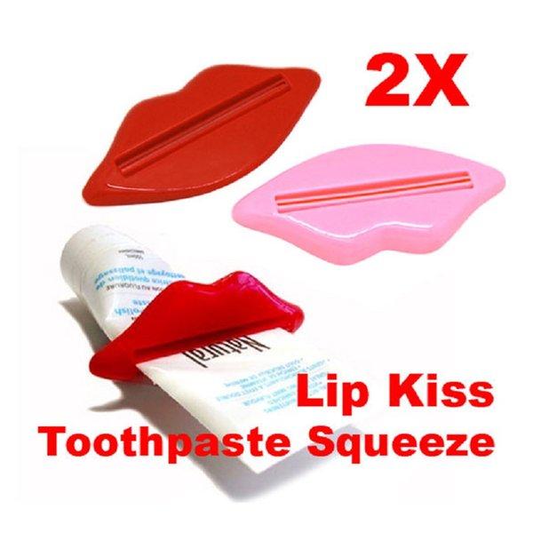 Productos de baño portátiles de moda Lip Kiss Dispenser Pasta de dientes Exprimir los labios para extruir Clip de pasta de dientes Venta caliente