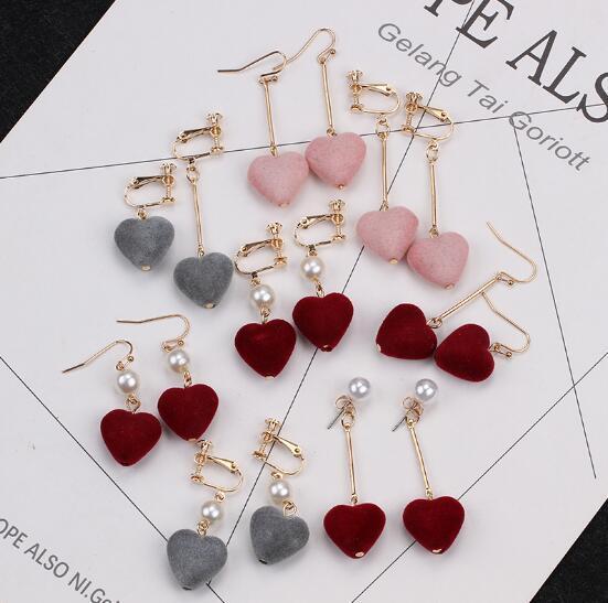 best selling Korean hot sell love earrings flannelette Heart-shaped unsymmetrical earrings girl's pearl sweet without ear cave ear clip