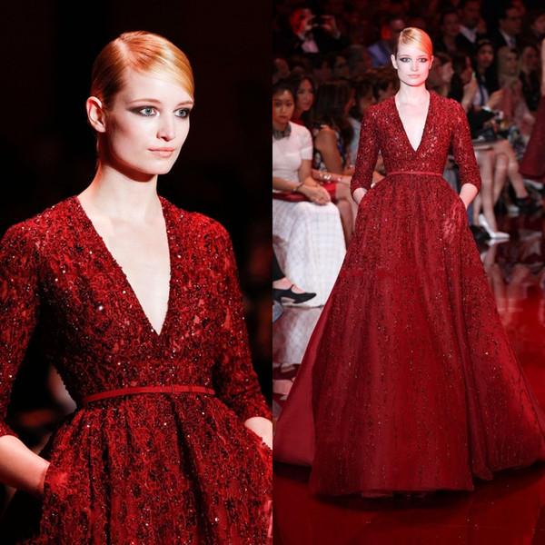 Hermosa Elie Saab Noble rojo Vestidos de noche Vestidos de celebridad Lentejuelas Brillante Profundo Escote en V Longitud del piso Manga larga Vestido formal de la pista
