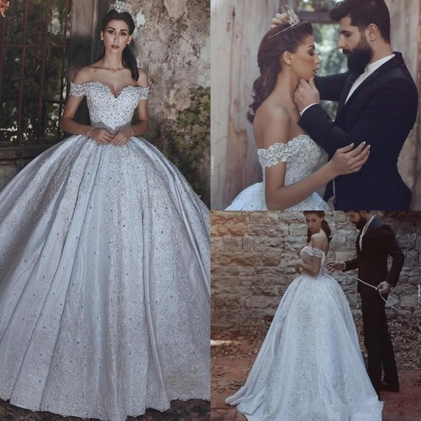 2017 Ball Gown Wedding Dresses Arabic Luxury Off Shoulder Short Sleeves Lace Applique Beads Crystal Corset Back Cathedral Train Bridal Gowns