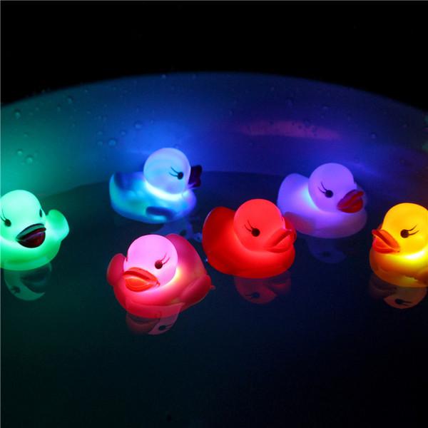 top popular Mini Flashing Duck LED Lighted Toy Baby Bath Glow Toys Kids Bathtub Luminous Floating Ducks 2021