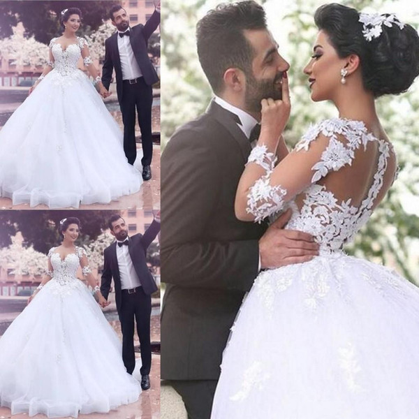 Saudi Arabic Middle East Ball Gown Wedding Dresses Sheer Jewel Long Sleeves Lace Appliques Button Back Long Vestidos Bridal Gowns
