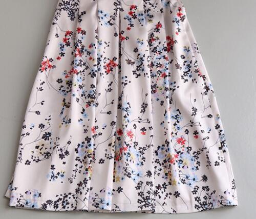 Taille haute pour l'été, jarretière fraîche, jupe mi-longue