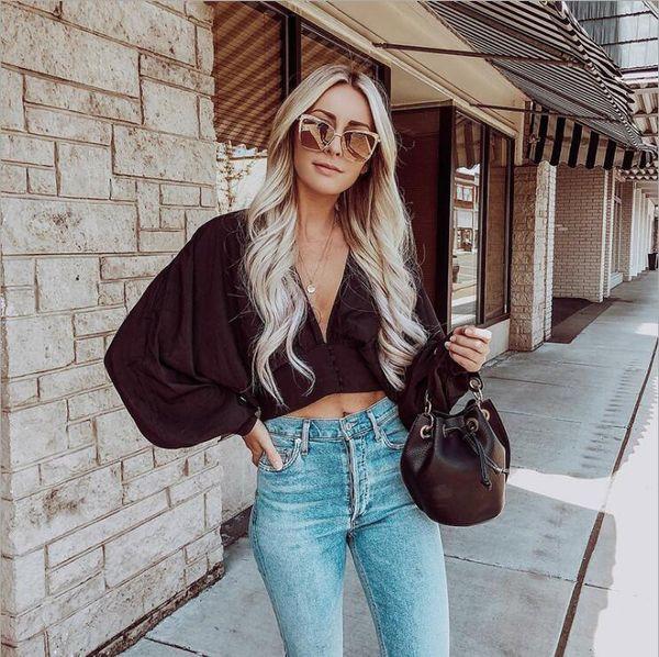 Blusa de manga de linterna de color puro con cuello en V sexy de Europa y América del otoño de 2019