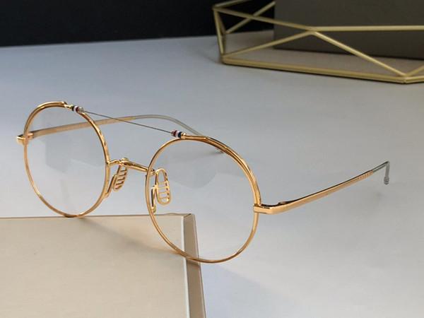Altın çerçeve saydam lens