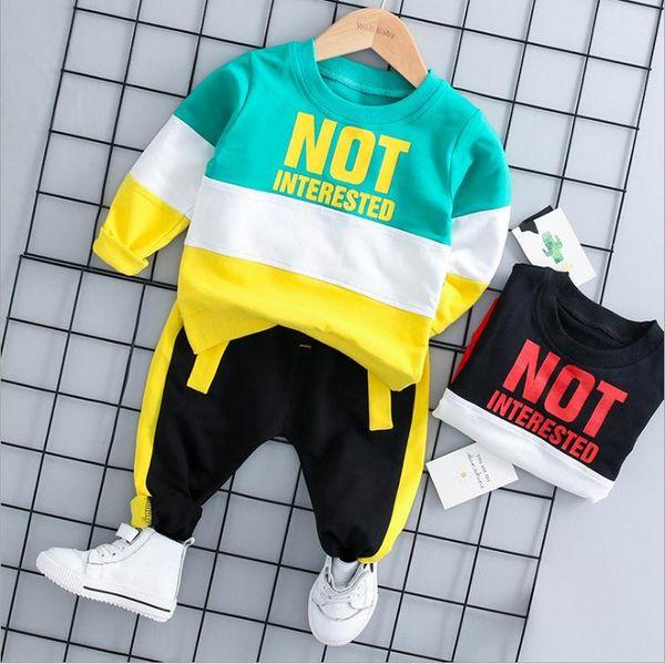 Ropa de bebé Otoño algodón letras impresas manga larga top + pants 2pcs Niños Ropa Trajes