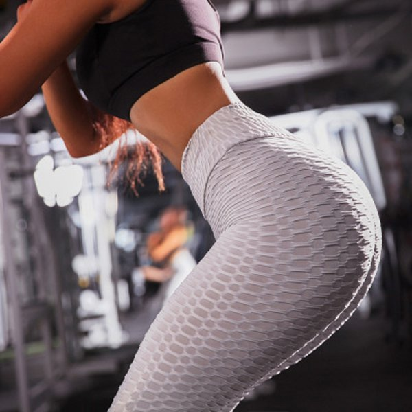 top popular Women Sports Yoga Pants 11 Colors Solid Fold Quick Drying Sexy Hip Pants Fitness Running High Elastic Fashion Tights Summer 2019 2019