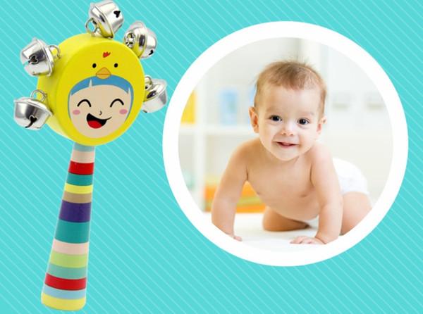 Caras de la sonrisa del bebé Campanas de mano de madera natural Sonajeros Educativos Jingle Ring Juguetes Niños / Niño Color al azar