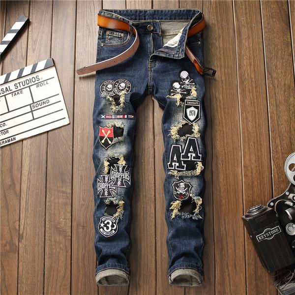Calças de brim dos homens moletom design original novo maré calças dos homens buraco adesivos pano estiramento bordado crânio pés elástico jeans