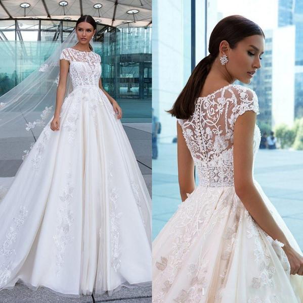 Pizzo eleganti abiti da sposa 2020 appliqued Una linea pura Bateau Neck Abiti da sposa pulsanti Indietro Cappella treno Tulle vestido de novia