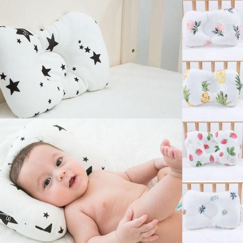 Le fil de soie d'oreiller doux et confortable de bébé nouveau-né empêche la tête plate anti-roulement