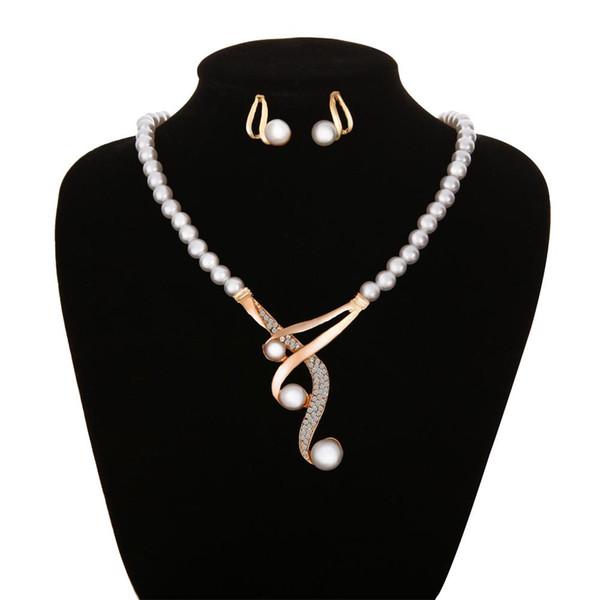 Forma de gancho Colgante de perlas de imitación con cuentas collar Pendientes joyería nupcial del partido conjunto nuevo