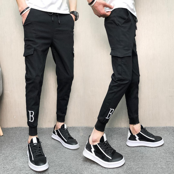 2019 Nueva moda termal y verano Moda casual para hombre Nueve puntos Beam Pantalones casuales Pies delgados Pantalones Ropa de hombre Pantalones de chándal