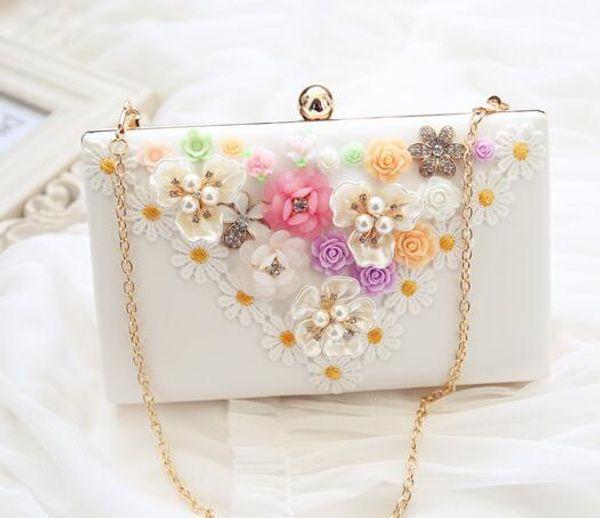 factory sells fashionable pearl flower woman Yanbao wedding dress Diamond Flower brand stereo hand bag lovely woman hand bag chain