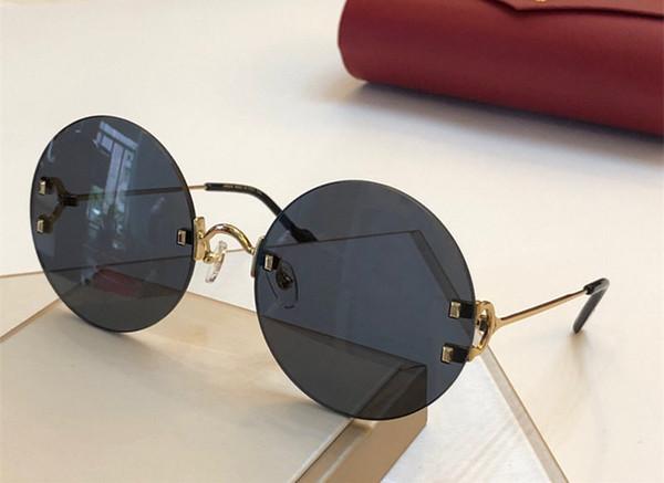 Diseñador de moda de lujo vendiendo gafas de sol redondas sin marco simples mujeres gafas UV400 protección decorativa gafas con caja roja 0152