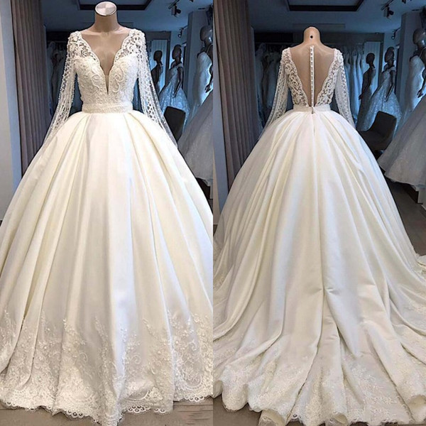 Modest Long Sleeve Ball Gown Wedding Dresses 2019 V Neck Backless illusion With Buttons Covered Plunging Dubai Arabic Bridal Gown